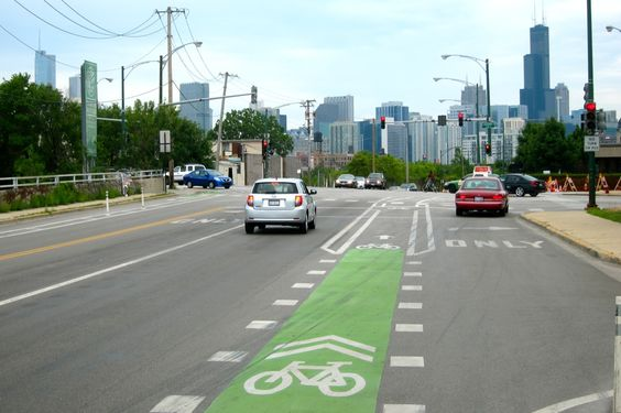 Green paint in Chicago reminding drivers that they're crossing cyclists' path.