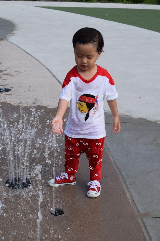 My son, Carnegie, wearing the cute Tot ( Black ) Hawks hockey logo.