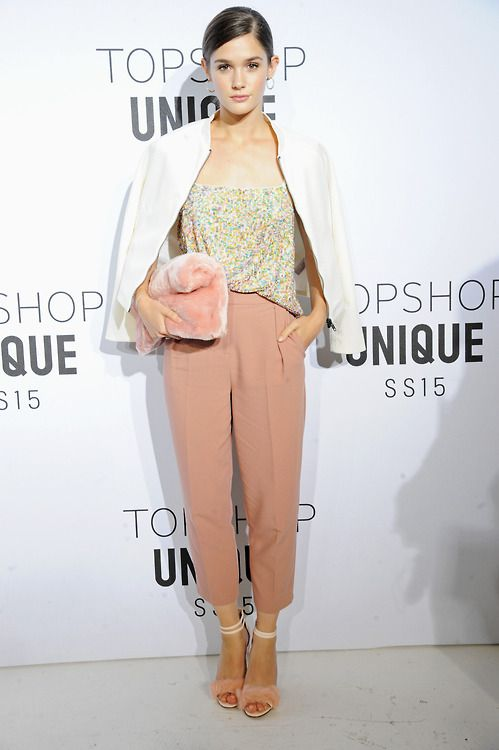 Sai Bennett arrives at the Topshop Unique SS15 show taking our fluffy heels and the faux fur clutch to another level.