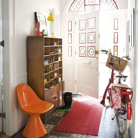 Love love LOVE the mid-century modern feel of this entry way. The colors. The wood. Heck, even the bicycle too!