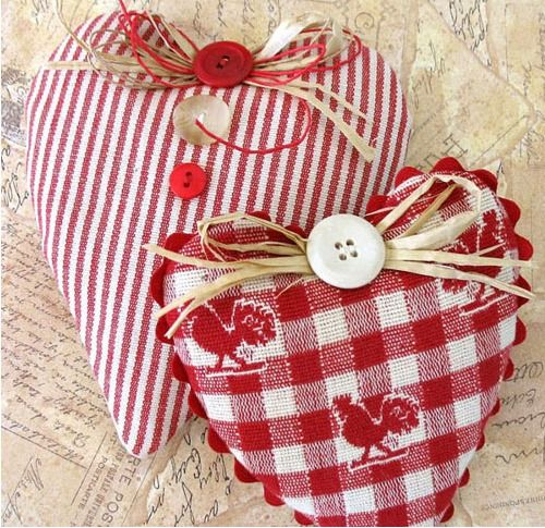 Thinking a garland of hearts made from old table clothes in a kitchen window would be a cherry touch.