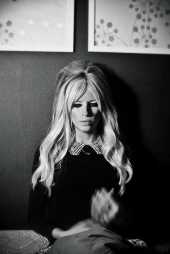 Bridget Bardot inspired hair: Shaggy layers and bangs.
