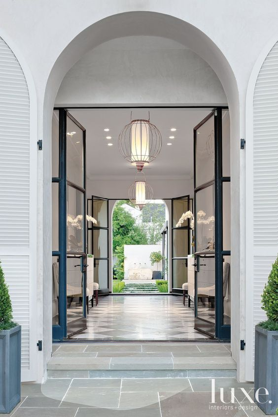 Glass and metal doors. Love the shutters!:
