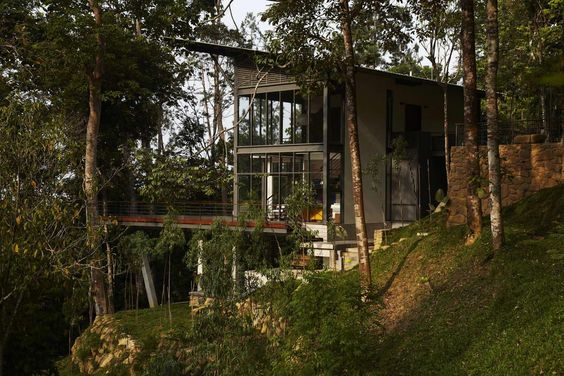 stunning modern glass house design in the forest plus elegant balcony under tree also two storey design home