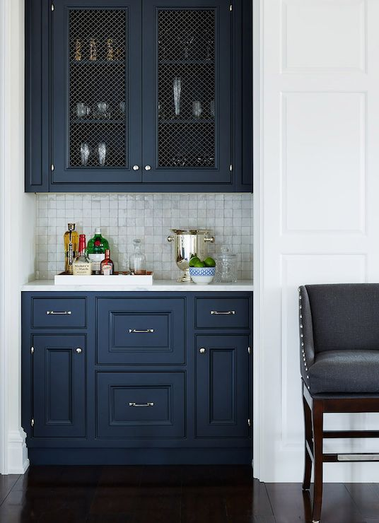 navy cabinets, pearlescent tile, wire screens on upper cabinets