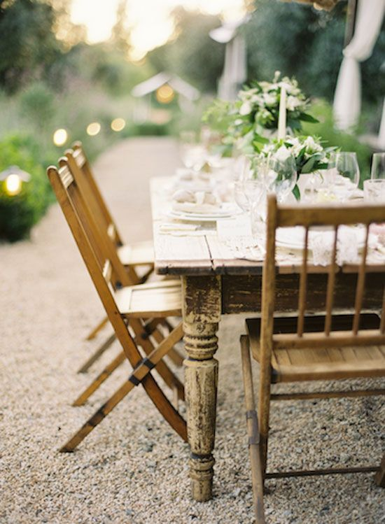 I really want a patch of gravel back behind our fruit trees to set a table up on for summer dining.