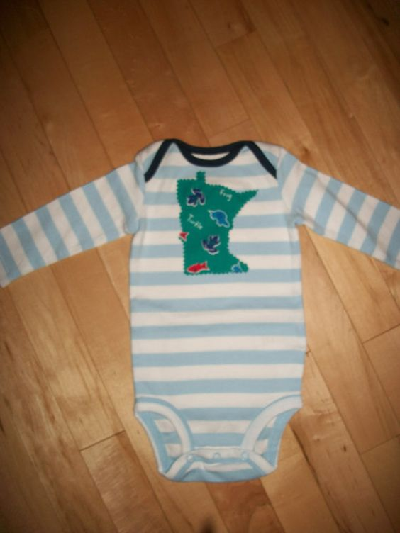 This upcycled Minnesota baby onsie is so adorable! The applique of frogs, fish & turtles so perfect for the little outdoor baby! It will make the-SOLD