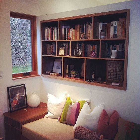 Custom built-in walnut plywood bookcase in a beautiful modern Seattle home.  By Kerf