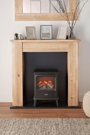During The Colder Months There S Nothing Cosier Than A Real Fire While It Isn T Quite The Same W Fireplace Surrounds Freestanding Fireplace Fireplace Heater