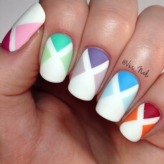 Multi colored x-shaped spring nail art design. This is a nail art design that is truly impressive when it comes to color hues. Simple and very interesting to look at you can recreate this on your own nails in no time.