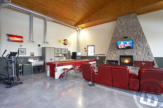 Nice tvs and floors on pinterest for Luxury garage interiors