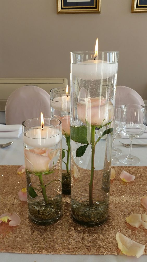Submerged flowers in cylinder vases