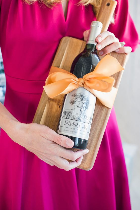 Tying your wine bottle to a nice cheese board is the perfect pairing for a nice holiday hostess gift. You can find cheese boards at all price points to make this method of wine gifting as affordable as you would like.