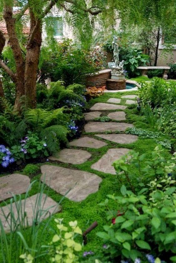 A Stone Front Yard Pathway With Moss In Between And Around For A Welcoming And Beautiful Pathway Landscaping Front Garden Design Front Yard Landscaping Design