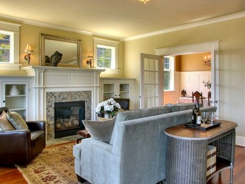 Small high windows on either side of fireplace #livingroom