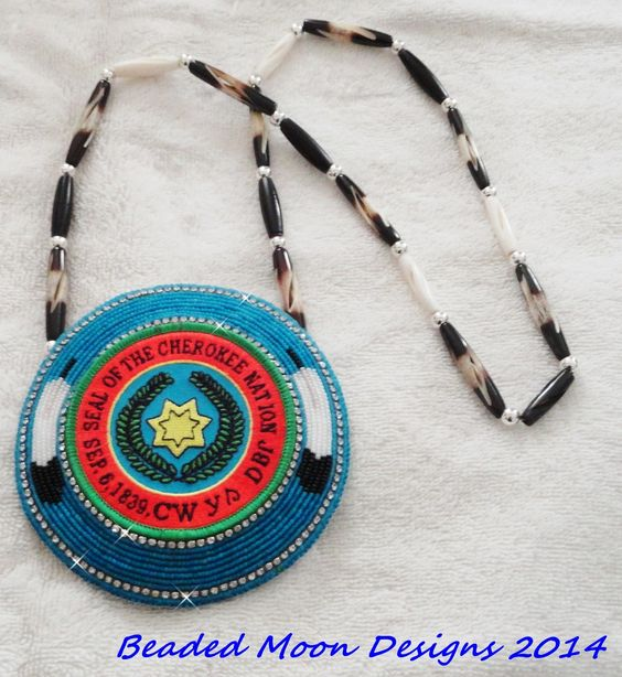 Cherokee Nation Seal Medallion, 4 1/2 in. on carved bone necklace ~ https://www.facebook.com/pages/Beaded-Moon-Designs/229870373249