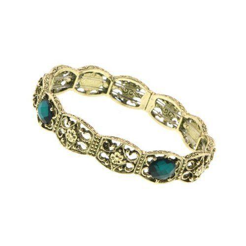 "Dionysis Gold and Emerald Bracelet 1928 Jewelry. $20.00. Measures: 7"" around x 1/2""W"