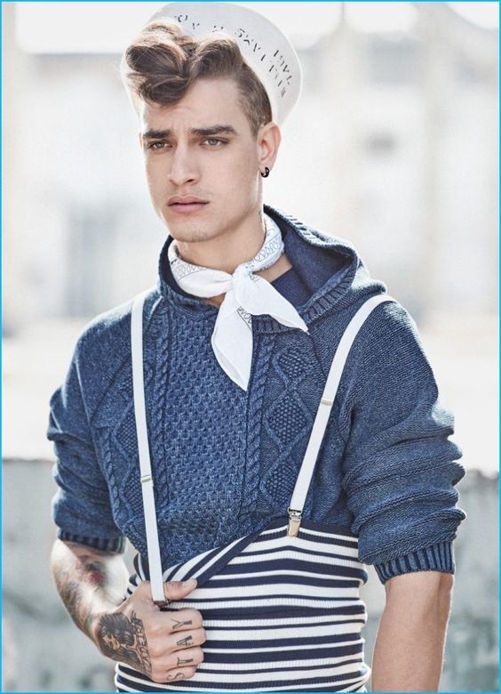 Jonathan Bellini rocks a pompadour while wearing an Ellus cableknit pullover with B.Luxo accessories and Minha Vo Tinha suspenders.