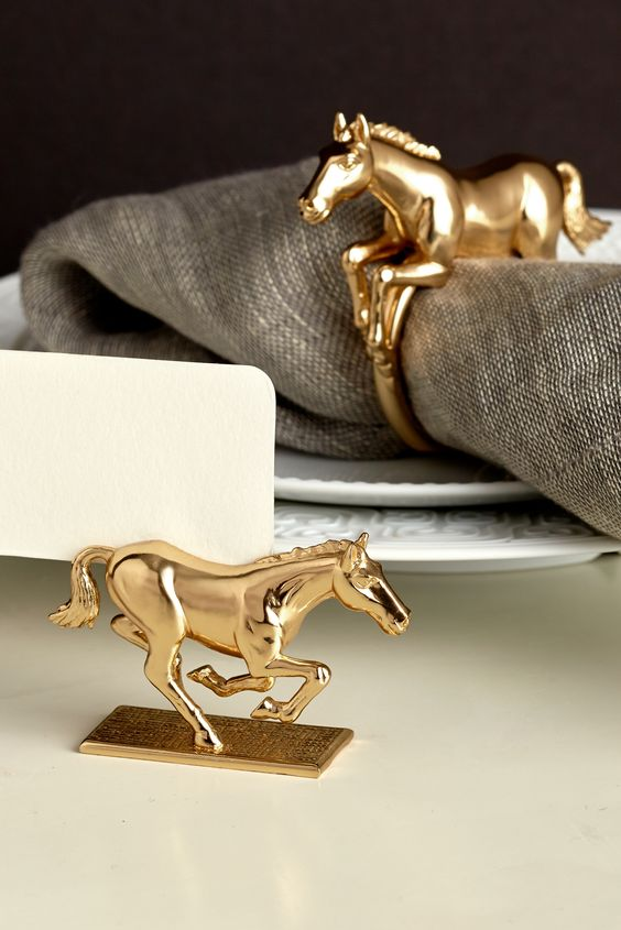 Gold horse napkin rings.: