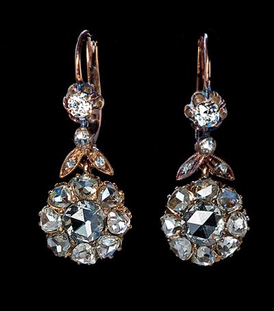 Antique Rose Cut Diamond Dangle Earrings, circa 1890. A pair of 14K gold lever back earrings features two sparkling clusters of antique rose cut diamonds with estimated total weight of 2.33 carats. The two center Dutch rose cut diamonds have an estimated combined weight of 0.76 ct. The two top stones are bright white old mine diamonds in buttercup settings (approx 0.30 ct tw). The stylized leaves are accented with 6 single cut diamonds. Estimated combined diamond weight 2.67 ct.: