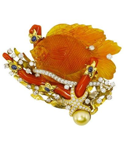 A carved fire opal, diamond, coral and sapphire brooch, Valentin Magro.
