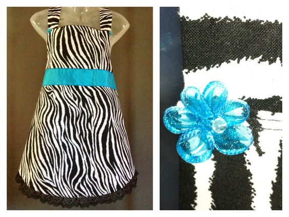 http://www.jsaprons.com/  Adult Fancy- Zebra print apron w blue ribbon $35  — at J's Aprons N Such.