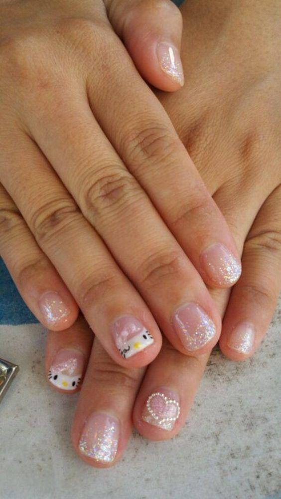 hello kitty & glitter nails