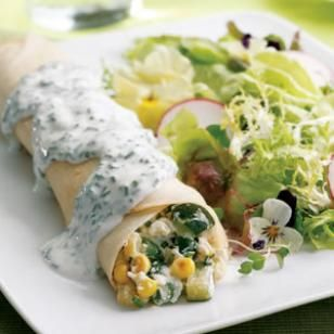 Summer vegetable crepes filled w/ zucchini, corn, green beans, ricotta cheese. chive cream sauce