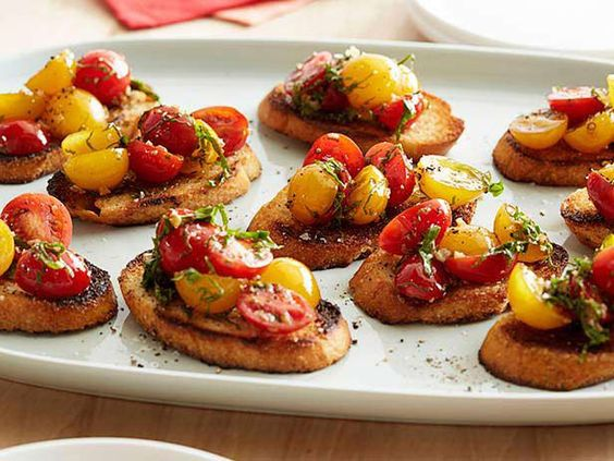 Welcome guests with an amazing array of appetizers like Ree's tomato-topped bruschetta.