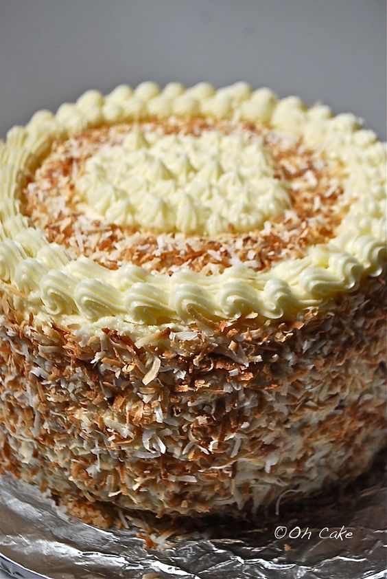 Eight Layer Coconut Lemon Cake with Raspberries & Toasted Coconut