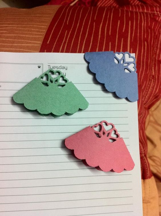 These are punched bookmarks made from craft paper.: