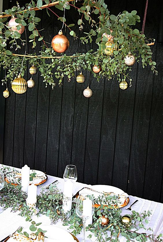 greens and gold ornaments table scape