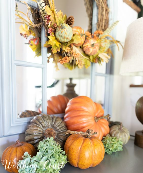 Check out 10 pretty fall decorating ideas you can copy when decorating your home for autumn. #fallvignette #diyfalldecor #falldecorideas #farmhousefalldecor #outdoorfalldecor #falldecorations #falldecoratingideas #pumpkins #pumpkinideas