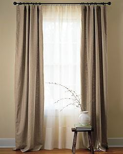 I love the look of sheer curtains behind panels. I just wish they had hung these a little higher so they didn't fall on the ground.