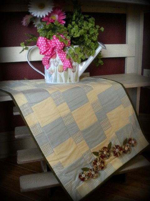 31 x 15 inch country table runner...done in soft butter cream & grey....sweet little yo-yo flowers have been hand stitched to both ends...great new spring item for the home...$35
