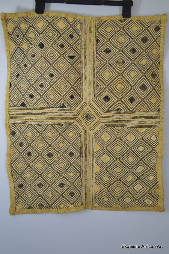 "A beautiful and symmetrical hand made Kuba Shoowa textile from the Kasai region of Kuba Kingdom Democratic Republic of Congo. This is signed ""Maxombo"" on t"
