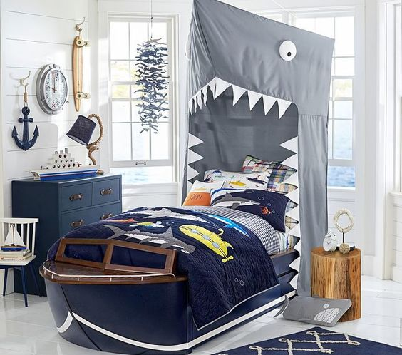 Kids are happy to speed off to bed when they get to sleep in this sleek boat, inspired by vintage cabin cruiser design. Fun details include a railed bow, low-profile windshield frame and underbed storage for a clever and playful addition to a nautical room.