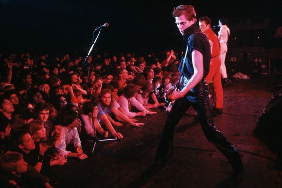 Paul Simonon onstage with The Clash. California, 1979 (Image by © Neal Preston/Corbis). From http://theselvedgeyard.files.wordpress.com.