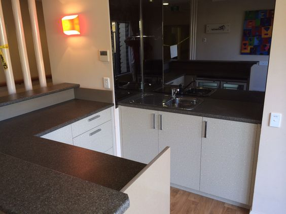 Laminate bench top, melamine doors and drawer fronts, mirror splashback