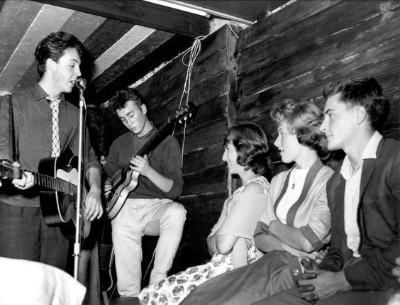Paul McCartney and John Lennon members of the 'The Quarrymen' rock and roll band perform on stage at the Casbah Coffee House, Liverpool, England in 1959.