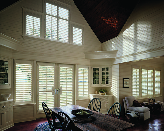 Hunter Douglas Heritance shutters work great in this dining room with 2-story windows