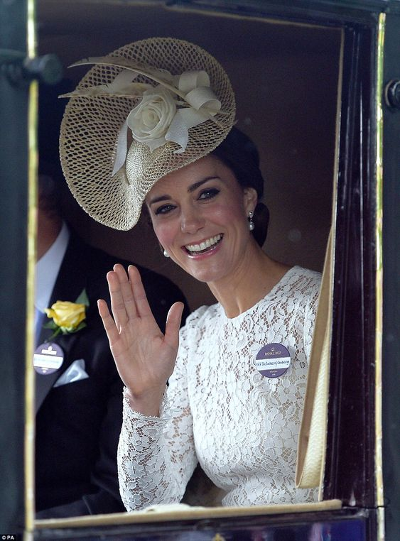 The Duchess of Cambridge arrived at Royal Ascot in a white lace dress with a gold fascinator embellished with a cream flower