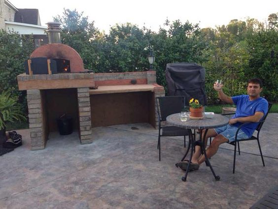 This Outdoor Kitchen includes the Cortile Barile Outdoor Pizza Oven and a Wood-Fired Argentinian BBQ Grill - And a nice little prep area to put it all together!  Well Done!  To see more pictures of this oven (and many more ovens), please visit - BrickWoodOvens.com
