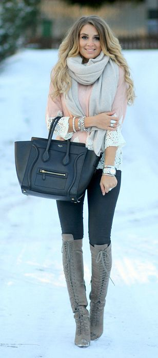 Light pink top with lace cuffs and bottom, grey scarf, grey bag, grey laced boots, dark wash jeans,