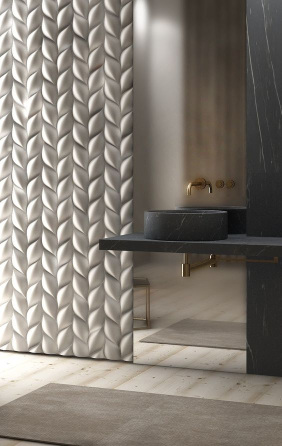 Pure luxury -  this cream 3D wall panel and black marbleesque sink is esquisite