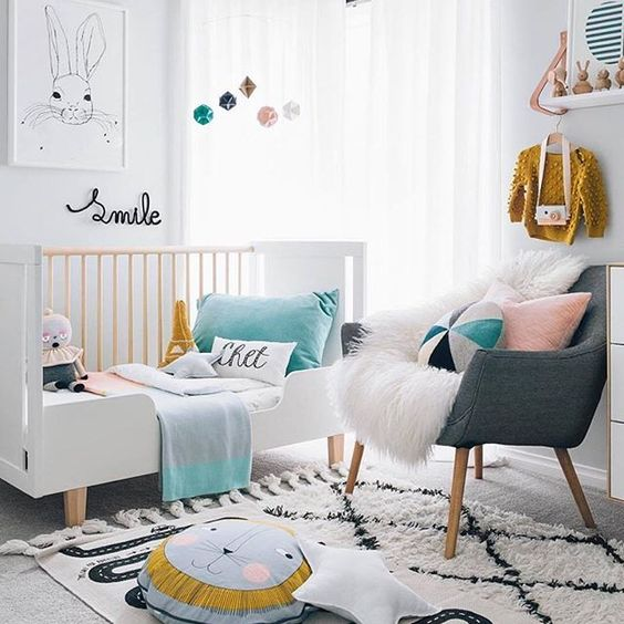 Kids need some #moderndesign love too! We're loving this room's soothing color palette (black and white with subdued pops of color!) in @oh.eight.oh.nine's home.