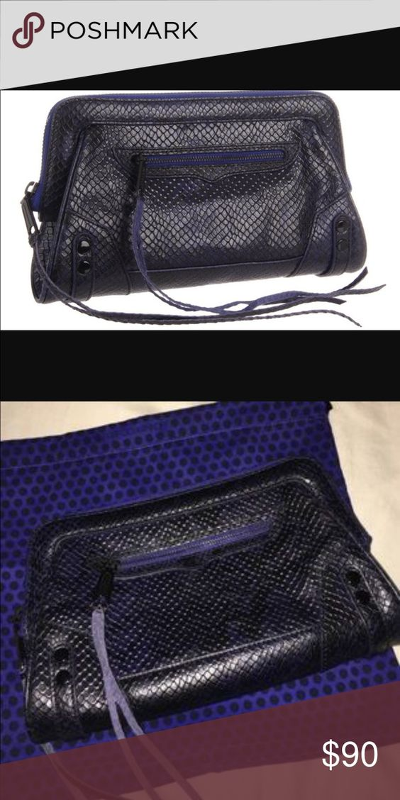 "Rebecca Minkoff Python Embossed Leather Clutch Super cute. great color. Like new, Perfect condition. #1016EB05 Condition: No dust bag. Stored at a smoke free and pet free environment. Color: Blue+black Python Embossed Leather Front zip pocket with tassel pull Zip top with tassel pull ~9.5"" (top)-10.75"" (bottom)L, ~7"" W, ~2.5"" D Blue with black polka dotted lining Full length zipper top closure 1 interior zippered pocket 1 interior slip pocket Rebecca Minkoff Bags"
