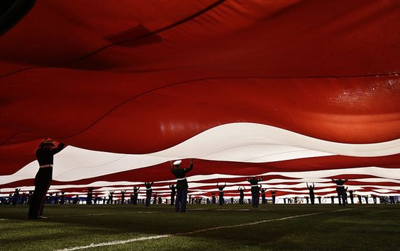 Credit: Gregory Bull/AP US Marines hold an American flag at the Holiday Bowl National Collegiate Athletic Association (NCAA) college footbal...