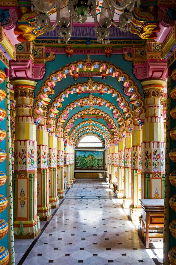 Colorful rainbow archways in the interior of Shantinath Mandir, a Jain temple in Jamnagar, a city in Gujarat state, India.