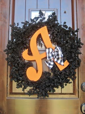 Spray painted black wreath with monogram.